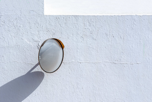 Round mirror and a white wall