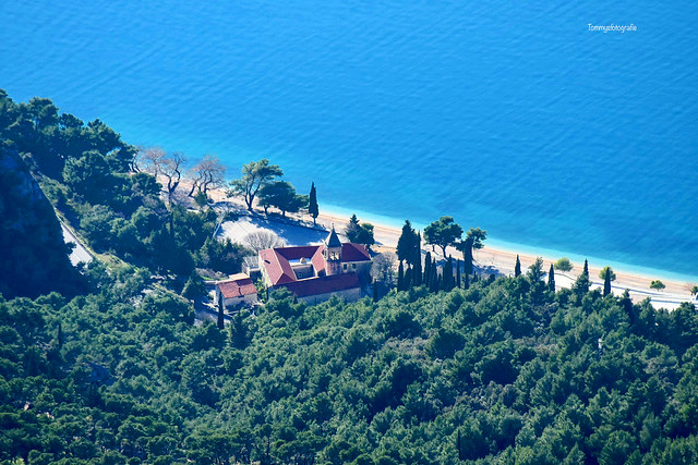 View from the Biokovo mountains down to the church and beach in Zivogošče