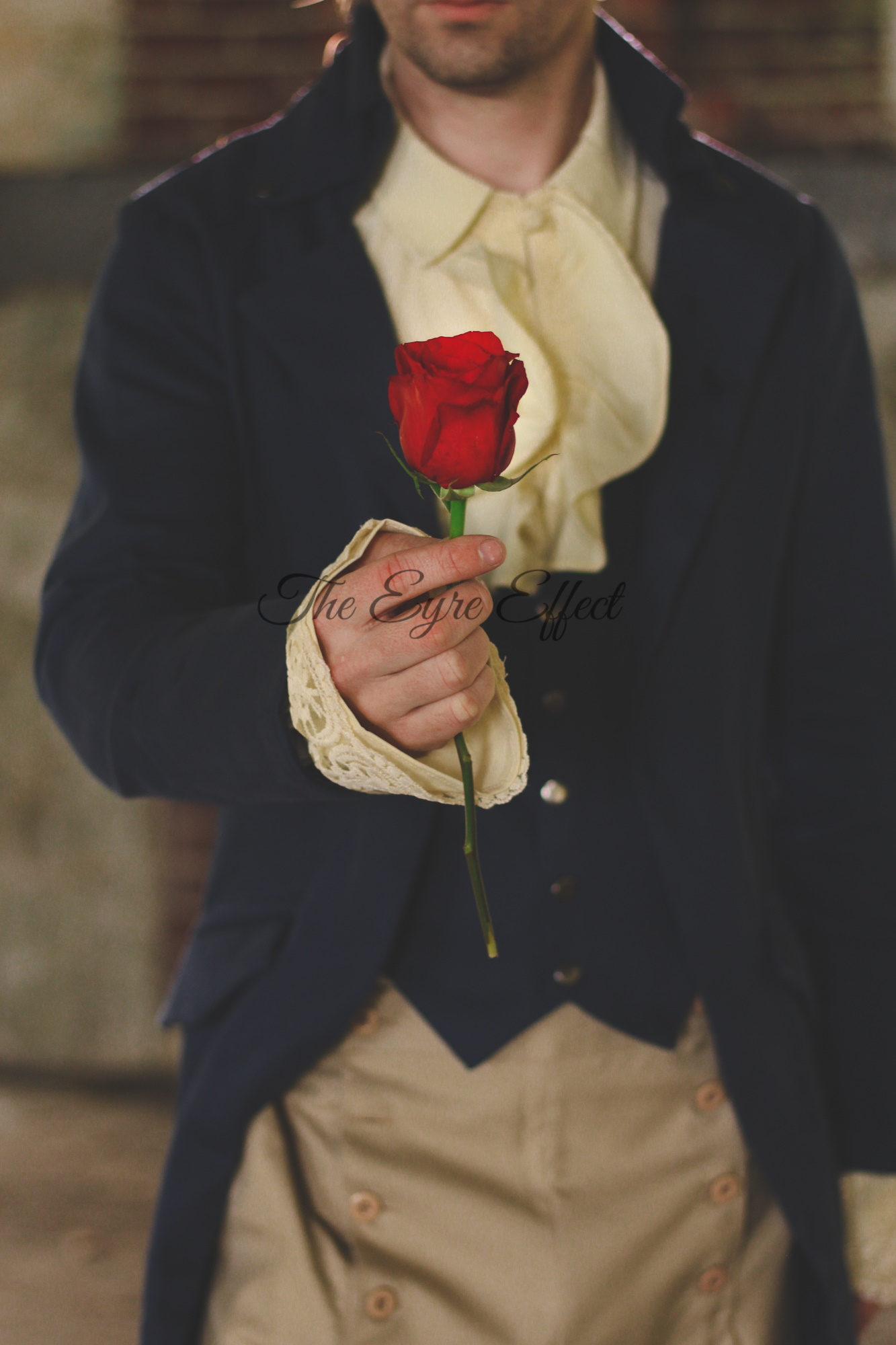 Beast offering Belle a rose photoshoot