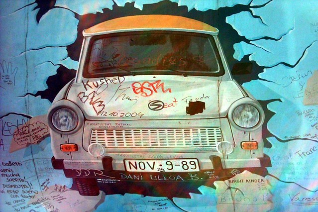 1200px-East_Side_Gallery_trabi