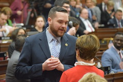 Rep. Davis talks with Rep. Floren on the opening day of the 2020 legislative session.