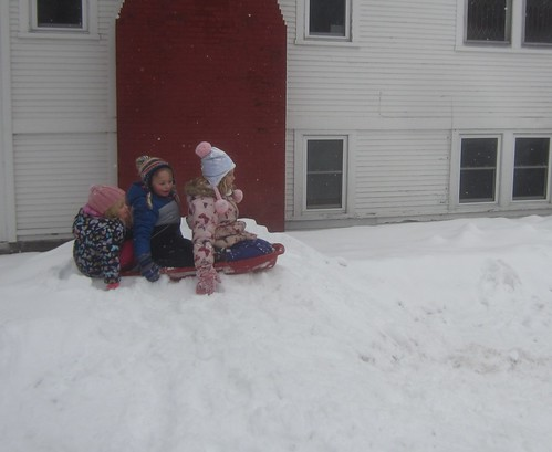 3 kids in a sled