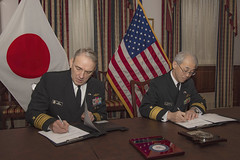 Vice Adm. Rick Williamson and JMSDF Rear Adm. Masatomi Dairiki, sign an agreement to improve interoperability for maritime logistics, Feb. 5. (U.S. Navy/MC2 Ford Williams)
