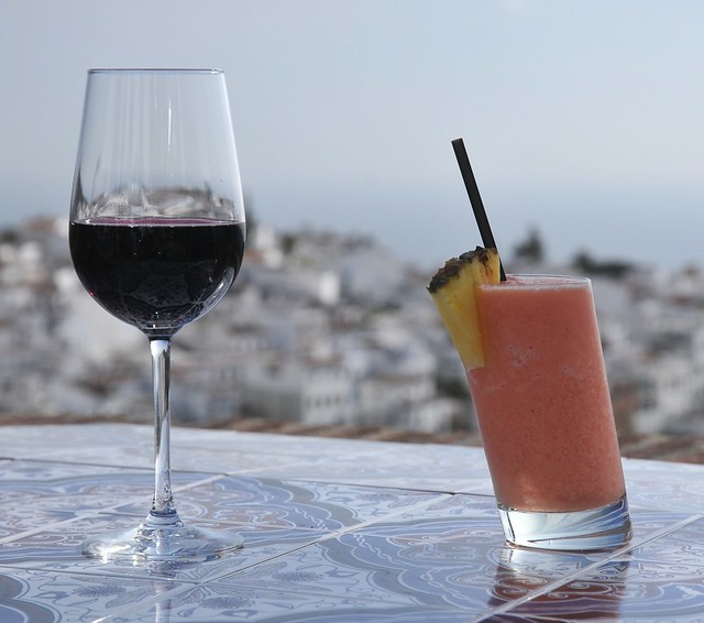 Relax with glass of red wine and coctail
