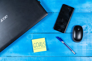 Business Goals concept with Lap Top and Mobile phone | by wuestenigel