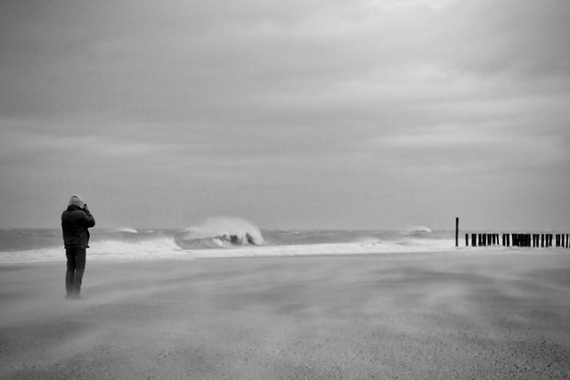 PHOTOGRAPHER (WOLFGANG) BETWEEN SAND AND WAVES