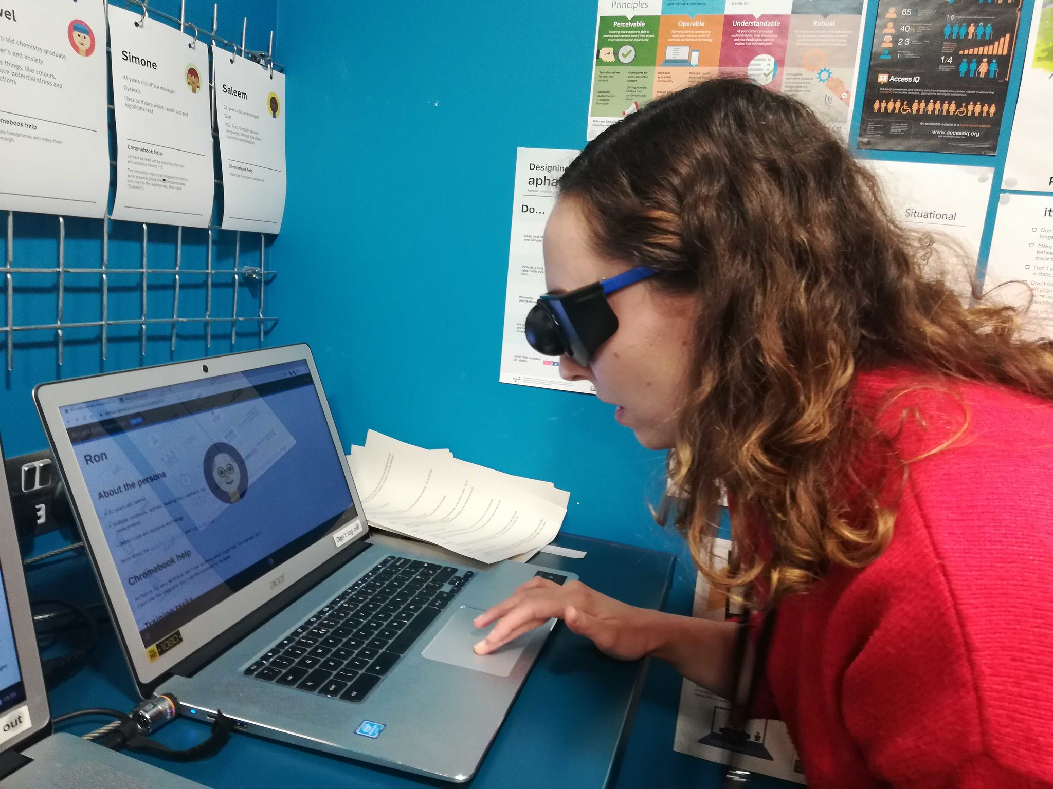 Stephanie using visual impairment simulation glasses