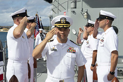 Capt. Al Alarcon salutes sideboys as he arrives for the USS Frank Cable (AS 40) change of command ceremony. (U.S. Navy/MC2 Heather Wamsley)