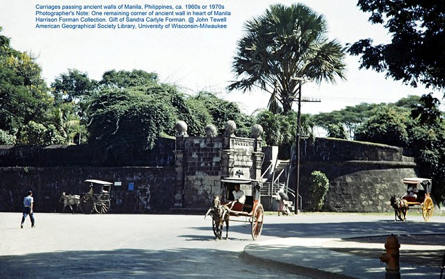 Carriages passing ancient walls of Manila, Philippines, ca. 1960s or 1970s