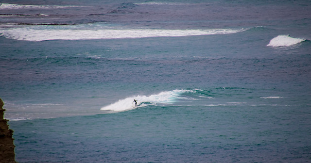 lone surfer in the blue expanse__