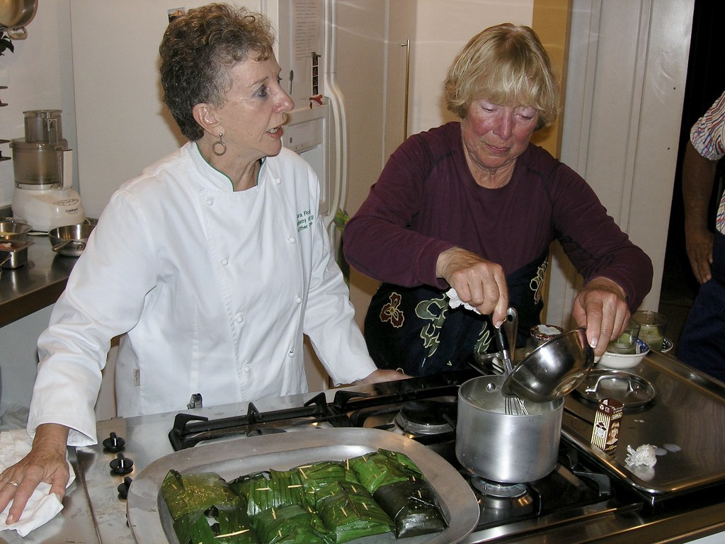 Yara and Jo working over the stove