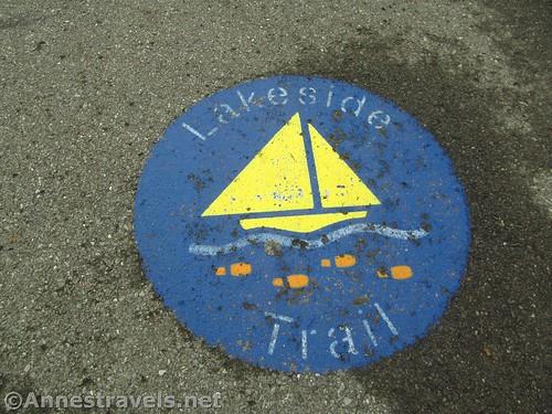 Sidewalk marking for the Irondequoit Lakeside Trail, Rochester, New York
