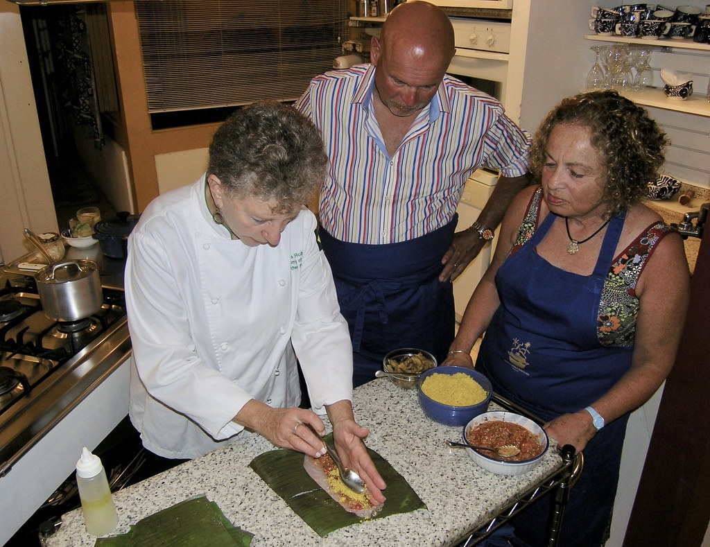 Yara demonstrates how to prepare the fish for cooking