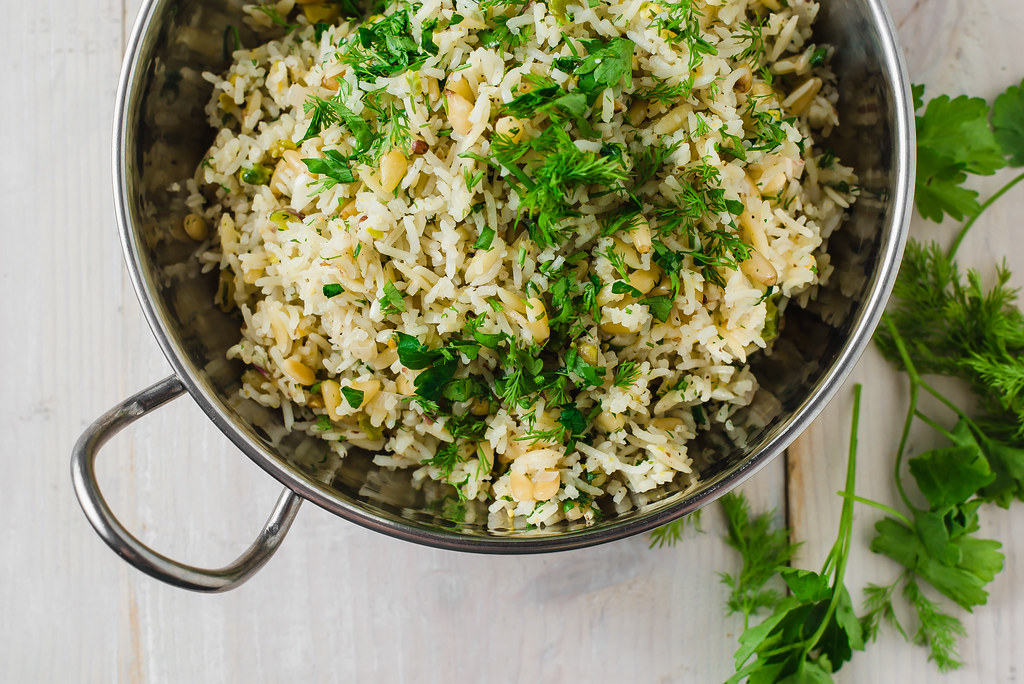 15 minutes for the most flavorful side dish. Lemon rice pilaf is cooked with orzo and toasted pine nuts, pistachios and loads of fresh herbs.