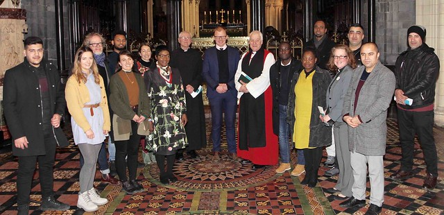 Archbishop Michael Jackson, Canon Horace McKinley and the Revd Abigail Sines with people who participated in the service and IRC staff.