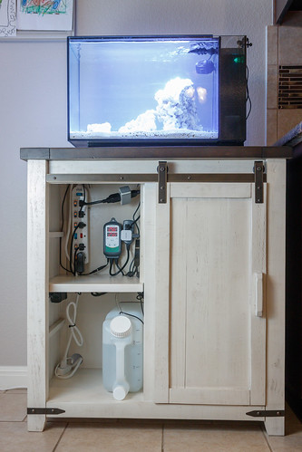 organized equipment and wiring in aquarium stand for fluval EVO
