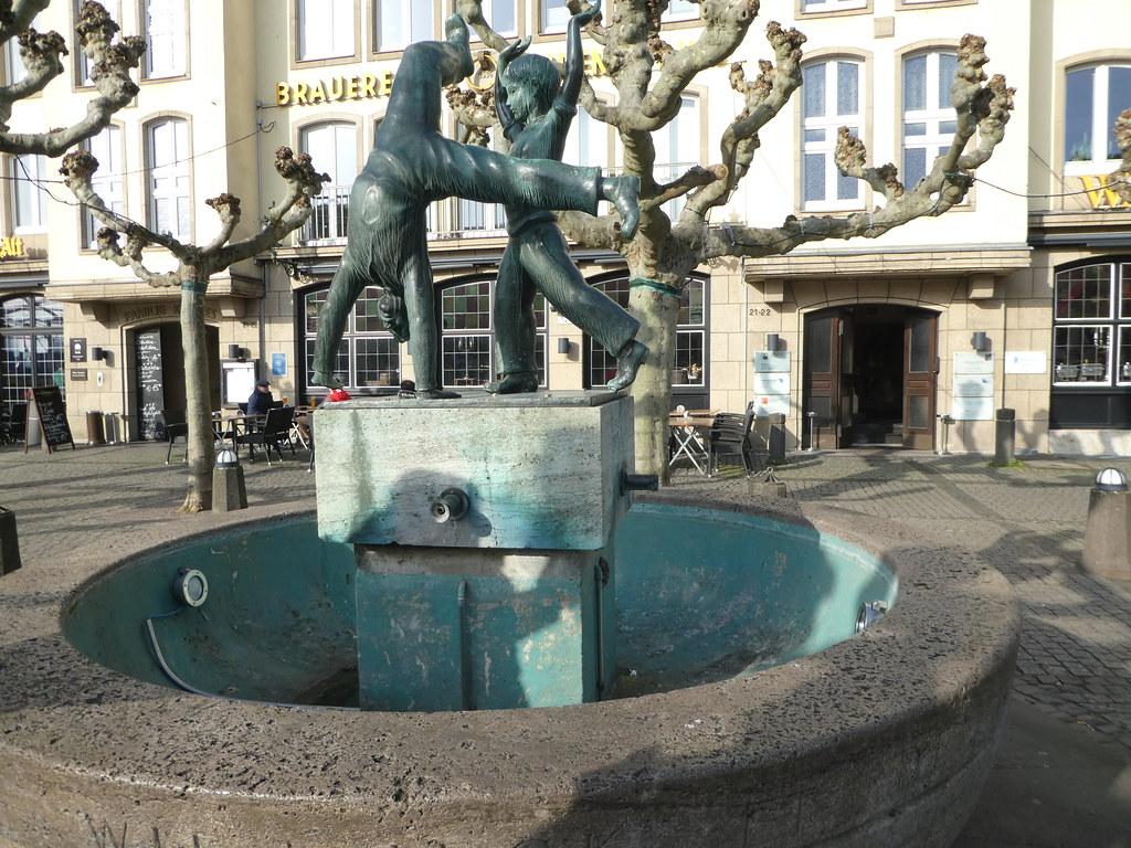 Statue of cartwheeling children in Burgplatz, Dusseldorf