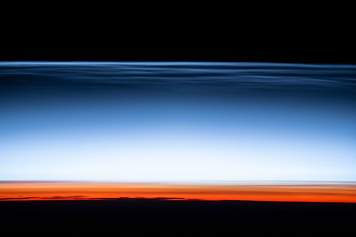 Noctilucent clouds, or night shining clouds | by NASA Johnson