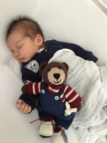 Linda's one week old great nephew with the Boy Bear by Little Cotton Rabbits that she knit for him