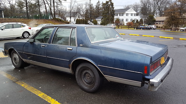 Rolling into our local 7-11 store's parking lot, I spotted this vestige of the past. I think it's a 1988 Chevy Caprice. Dented, scratched, rusty and missing body panels. The engine works but sounded pretty rough. Feb. 2020