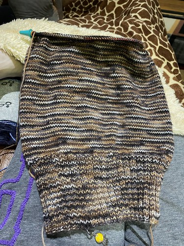 Jen has her husband knitting! This is a progress shot of his second hat, the first was a chunky knit while this one is fingering!! Awesome job!
