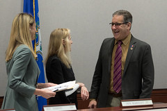 State Rep. John Fusco talks with State Rep. Caroline Simmons and State Senator Joan Hartley after a meeting of the Commerce Committee.