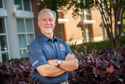 Scott Kramer stands outside the Gorrie Center, the home of the McWhorter School of Building Science at Auburn University.