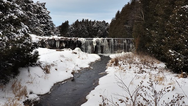 Winter waterfall over former mill pond dam, Horning's Mills, Dufferin County, Ontario
