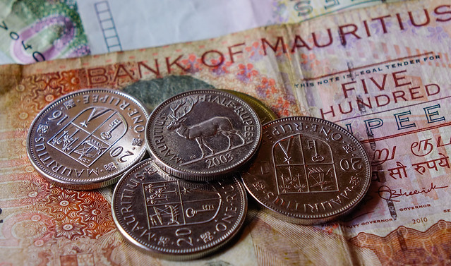 Mauritian rupee bill note with coins