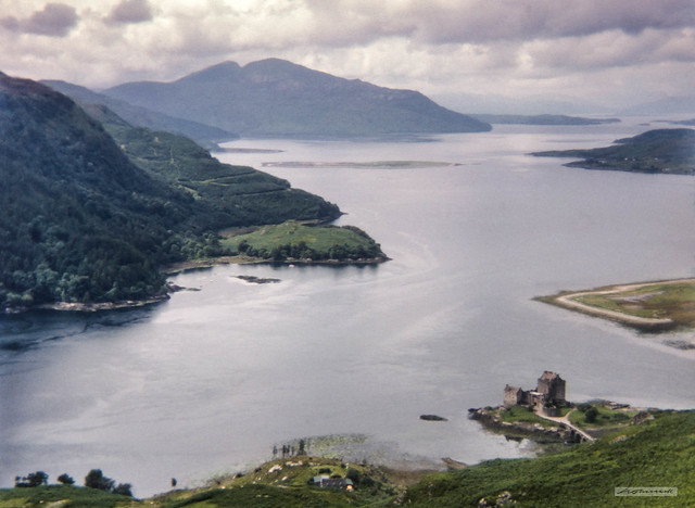 Eilean Donan Castle where Loch Duich meets Loch Alsh with the Isle of Skye and Kyle of Lochalsh in the distance.