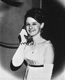 Student talking with her escort to the Moonlight and Mistletoe Dance at the Sheraton  in 1969 at Nazareth Academy in Philadelphia, PA