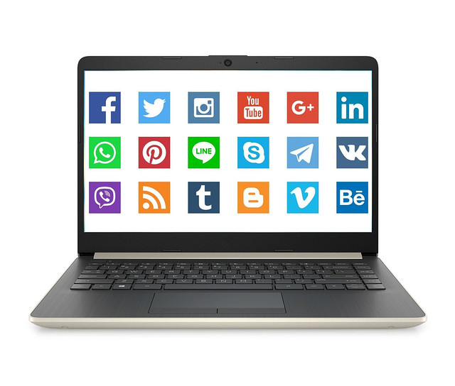 Opened laptop with social network icons