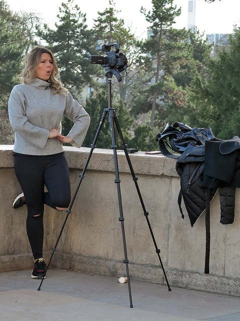 Curious expression of a girl filming herself uttering a speech