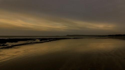 2020 beach cloneastrand dungarvan landscape outdoor reflection rocks strand sunset water winter clouds coast coastal coastline ireland sea sky stones waterford
