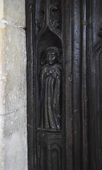 south door: a cloaked figure with crossed arms (16th Century)