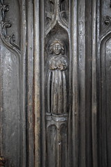 south door: a cloaked figure blessing (16th Century)