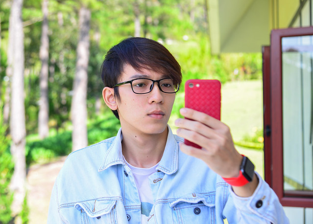 Asian young man making selfie by smartphone