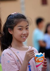 A smiling young Chinese girl, Kunming Old Town, Yunnan, China
