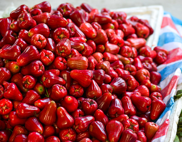 Red plum fruits for sale at local market