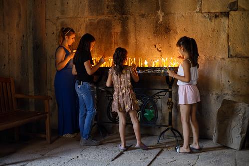 halidzor syunik armenia tatev monastery people prayer candle fire family christian christianity