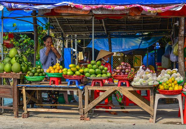 A vendor selling fresh fruits at a rural market