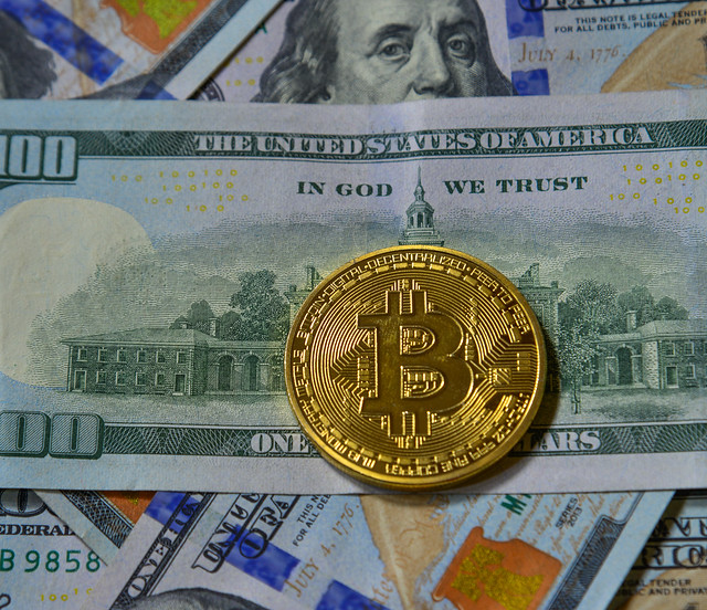 Golden bitcoin on USD 100 billnote dollar