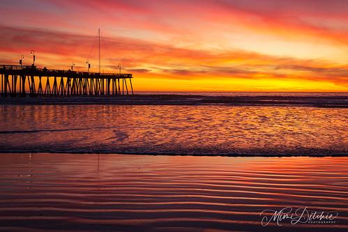 pismo pismobeach pismopier coast coastline ocean pier sand shore sunset water waves getty gettyimages mimiditchie mimiditchiephotography cloud clouds