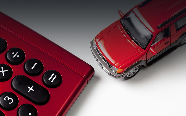 Calculator and toy car on white background