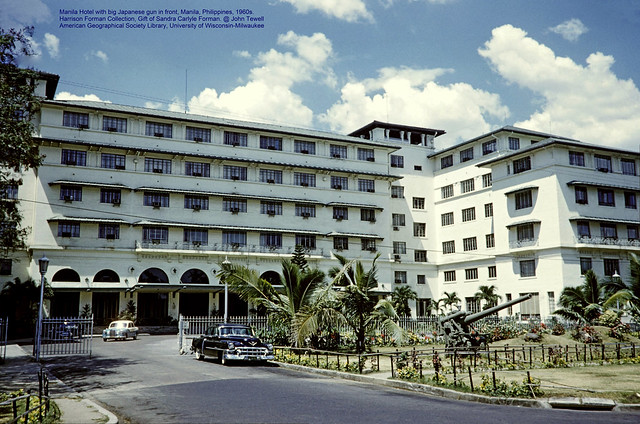 Manila Hotel with WWII Japanese gun in front, Manila, Philippines, 1960s.