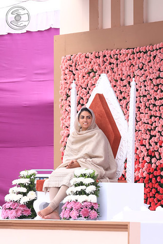 Her Holiness blessing from the dais