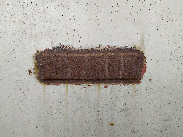 Dirty white wall texture with rusty metal