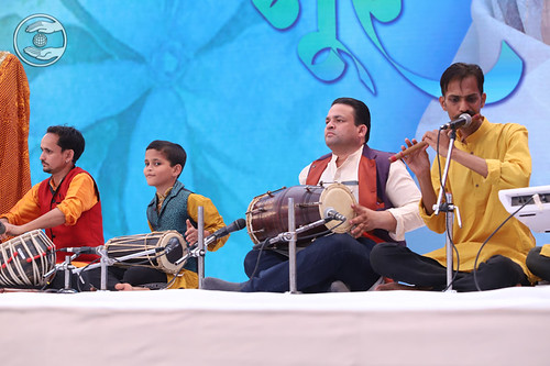 Devotees playing different musical instrument