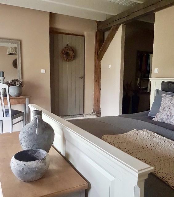 Slaapkamer houten balk landelijke stijl