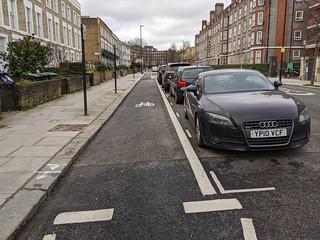 Fig 1:Track behind parked cars west of zebra